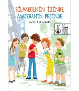 Bilmecenin İzinde Maceranın Peşinde - Dursun Ege Göçmen - Tudem Yayınları